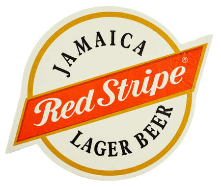 kingston: KINGSTON, JAMAICA - MARCH 15, 2015: Beermat of Jamaican beer Red Stripe lager beer isolated over white background