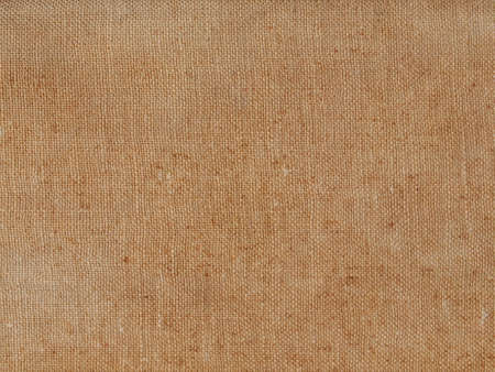 Brown hessian burlap texture useful as a background