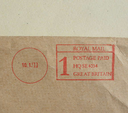 first class: Postage meter for urgent first class by air mail Stock Photo