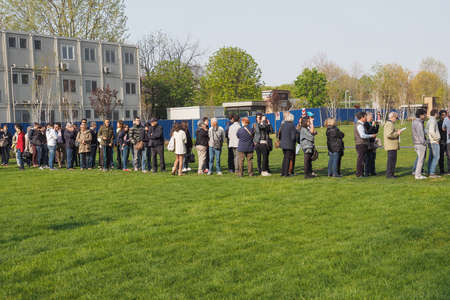 queueing: TURIN, ITALY - APRIL 11, 2015: People queueing to visit the new Intesa San Paolo skyscraper designed by Renzo Piano Building Workshop which just opened today and is the highest building in Turin