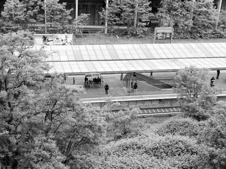 berg: BERLIN, GERMANY - MAY 12, 2014: People waiting at Landsberger Allee station in the Prenzlauer Berg district served by the SBahn lines S41 S42 S8 and S9 in black and white
