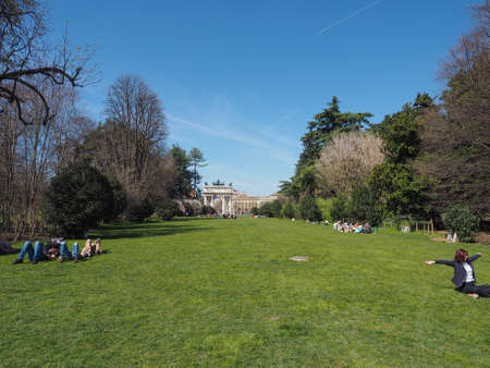 visiting: MILAN, ITALY - MARCH 28, 2015: People visiting the Parco Sempione large central park