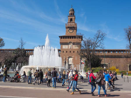 sforzesco: MILAN, ITALY - MARCH 28, 2015: People visiting the Sforza Castle aka Castello Sforzesco which is the oldest castle in town