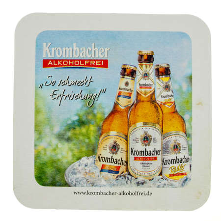 german alcohol: KREUZTAL, GERMANY - MARCH 15, 2015: Beermat of German alcohol free beer Krombacher isolated over white background