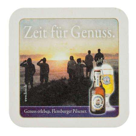 pilsner: FLENSBURG, GERMANY - MARCH 15, 2015: Beermat of German beer Flensburger Pilsner isolated over white background