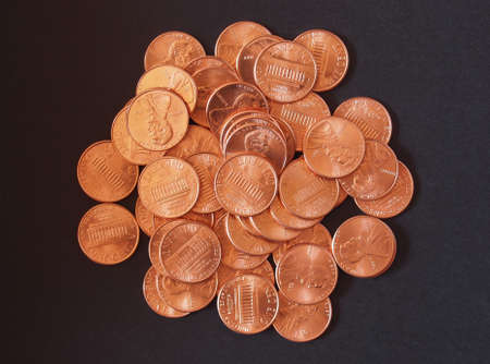 One cent wheat penny coin currency of the United States over black background photo