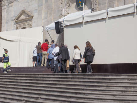 TURIN, ITALY - APRIL 22, 2015: People queueing in front of Turin cathedral to visit the Holy Shroud of Turin Editorial