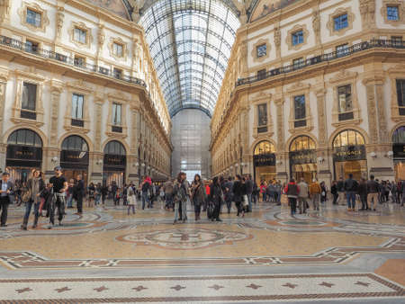 recently: MILAN, ITALY - MARCH 28, 2015: Tourists visiting the Galleria Vittorio Emanuele II recently restored for the Expo Milano 2015 international exhibition Editorial