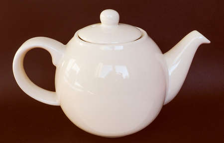 for tea: Vintage looking White ceramic teapot for tea