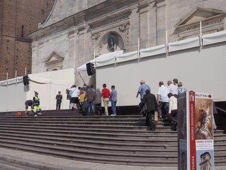 shroud: TURIN, ITALY - APRIL 22, 2015: People queueing in front of Turin cathedral to visit the Holy Shroud of Turin Editorial