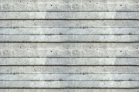 Seamless tileable texture useful as a background - grey concrete wall