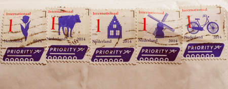 nederland: Vintage looking AMSTERDAM, NETHERLANDS - FEBRUARY 11, 2015: Series of stamps printed by Dutch post for international priority mail Editorial