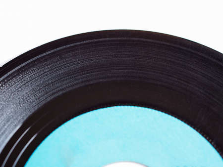 record label: Vinyl record vintage analog music recording medium with blue label