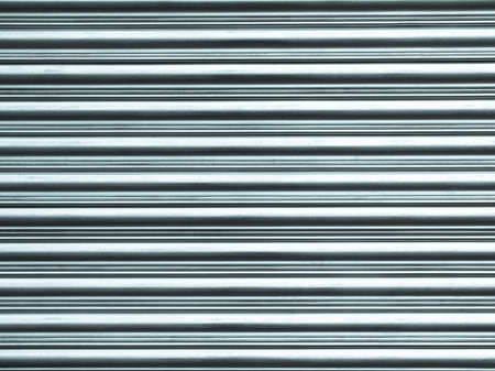 corrugated steel: Corrugated steel shutter useful as a background - cool cold tone
