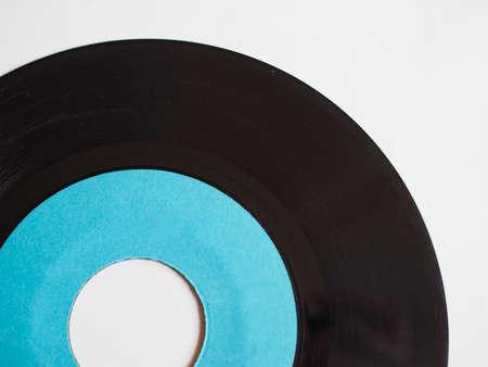 the medium: Vinyl record vintage analog music recording medium with blue label