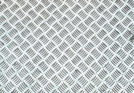 diamond plate: Diamond steel plate useful as a background - cool cold tone