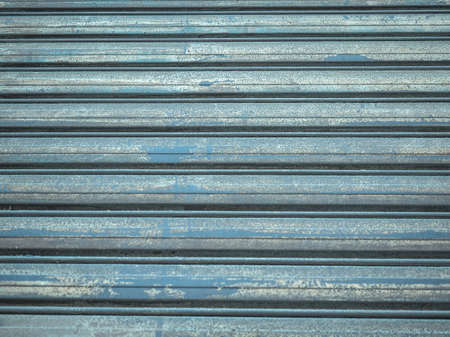 sectional door: Metal roller shutter door useful as a background - cool cold tone Stock Photo
