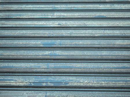 sectional door: Metal roller shutter door useful as a background - cool cold tone Stock Photo