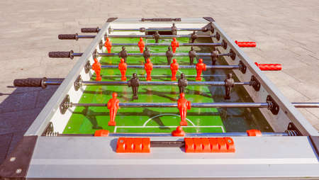 kicker: Vintage looking Table football aka table soccer, foosball from the German Tischfussball, baby-foot or kicker table-top game and sport