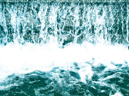 Detail of a water fall or cascade with foam - cool cold tone photo