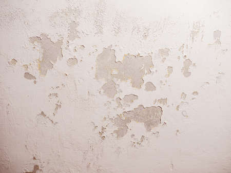 Vintage looking Damage caused by damp and moisture on a wall