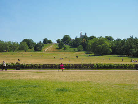 greenwich: LONDON, UK - JUNE 11, 2015: Visitors at Greenwich park on Royal Observatory hill