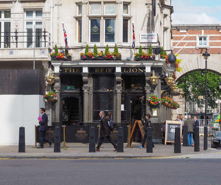 elite: LONDON, UK - JUNE 09, 2015: The Red Lion pub situated in London political heart near the Houses of Parliament has been the favoured pub of the political elite for centuries