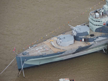 permanently: LONDON, UK - JUNE 10, 2015: HMS Belfast ship originally a Royal Navy light cruiser is now permanently moored on the River Thames as a museum ship