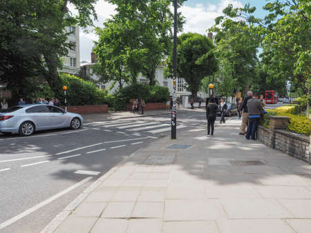 album cover: LONDON, UK - JUNE 10, 2015: Abbey Road zebra crossing made famous by the 1969 Beatles album cover
