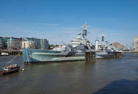 permanently: LONDON, UK - JUNE 11, 2015: HMS Belfast ship originally a Royal Navy light cruiser is now permanently moored on the River Thames as a museum ship Editorial
