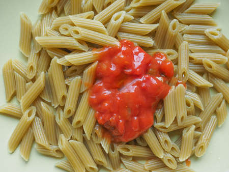 tomato sauce: Penne pasta with tomato sauce Stock Photo