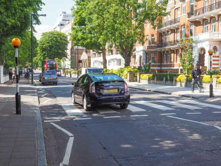 zebra crossing: LONDON, UK - JUNE 10, 2015: Abbey Road zebra crossing made famous by the 1969 Beatles album cover
