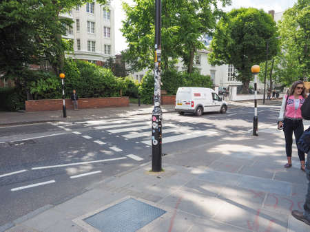 the beatles: LONDON, UK - JUNE 10, 2015: Abbey Road zebra crossing made famous by the 1969 Beatles album cover