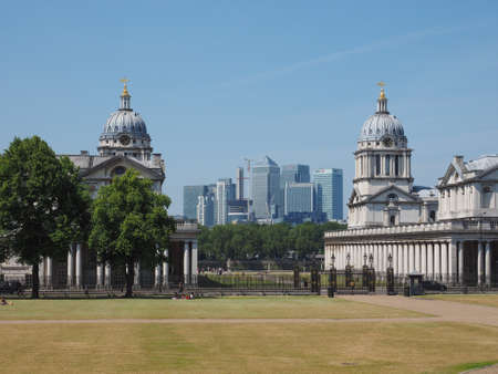 greenwich: LONDON, UK - JUNE 11, 2015: The Canary Wharf business centre which is the largest business district in the United Kingdom seen from Greenwich park Editorial