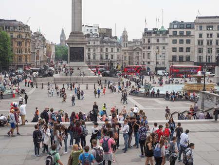 visiting: LONDON, UK - JUNE 12, 2015: Tourists visiting Trafalgar Square