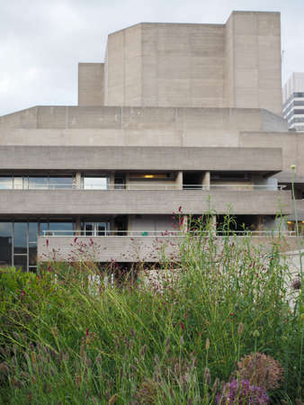 sir: LONDON, UK - JUNE 09, 2015: The National Theatre designed by Sir Denys Lasdun is a masterpiece of new brutalist architecture Editorial