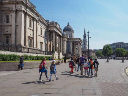 trafalgar: LONDON, UK - JUNE 11, 2015: Tourists visiting Trafalgar Square in front of the National Gallery
