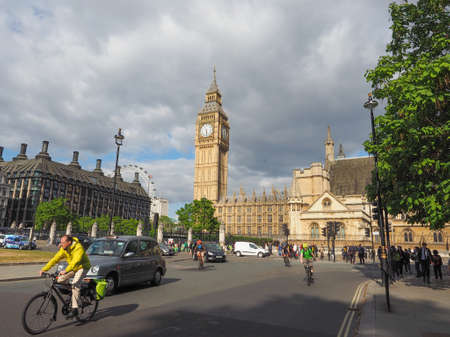 parliament square: LONDON, UK - JUNE 09, 2015: Tourists in Parliament Square in Westminster Editorial