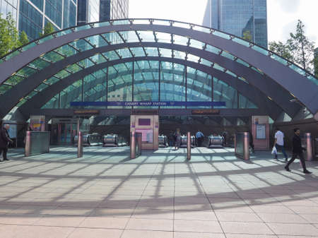 LONDON, UK - JUNE 10, 2015: Travellers at Canary Wharf underground station Editorial