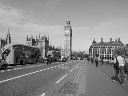 bigben: LONDON, UK - JUNE 10, 2015: Houses of Parliament aka Westminster Palace seen from Westminster Bridge in black and white Editorial
