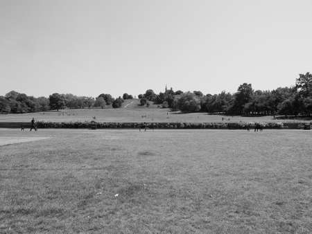 visitors: LONDON, UK - JUNE 11, 2015: Visitors at Greenwich park on Royal Observatory hill in black and white