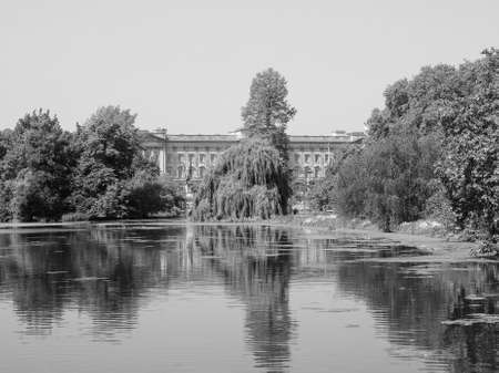 buckingham palace: LONDON, UK - JUNE 11, 2015: St James Park with Buckingham Palace in the background in black and white Editorial