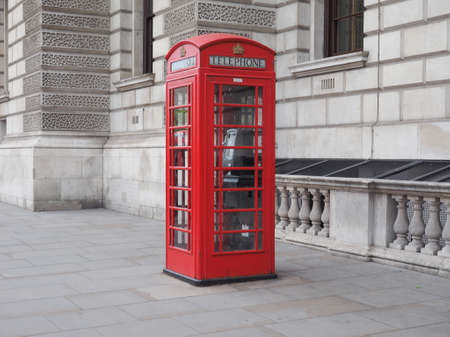 red telephone: Traditional red telephone box in London, UK Stock Photo