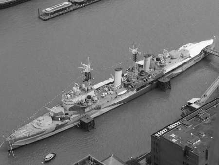 LONDON, UK - JUNE 10, 2015: HMS Belfast ship originally a Royal Navy light cruiser is now permanently moored on the River Thames as a museum ship in black and white