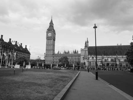 parliament square: LONDON, UK - JUNE 09, 2015: Tourists in Parliament Square in Westminster in black and white