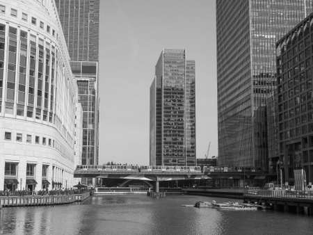 business centre: LONDON, UK - JUNE 11, 2015: The Canary Wharf business centre is the largest business district in the United Kingdom in black and white