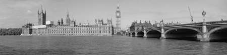 westminster bridge: LONDON, UK - JUNE 10, 2015: High resolution panoramic view of the Houses of Parliament Big Ben and Westminster Bridge seen from river Thames in black and white Editorial