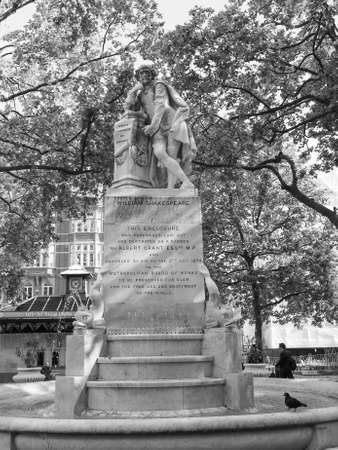LONDON, UK - JUNE 10, 2015: Statue of William Shakespeare built in 1874 in Leicester Square in black and white Editorial