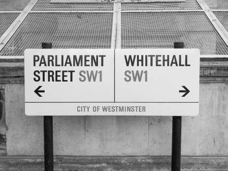 city of westminster: LONDON, UK - JUNE 09, 2015: Parliament Street and Whitemall sign in the City of Westminster in black and white