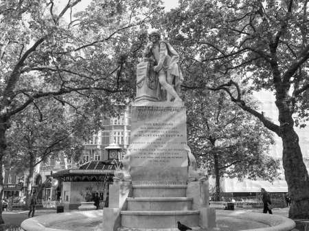 leicester: LONDON, UK - JUNE 10, 2015: Statue of William Shakespeare built in 1874 in Leicester Square in black and white Editorial